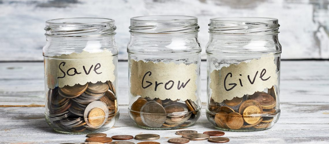 Glass containers with coins. Save your budget.