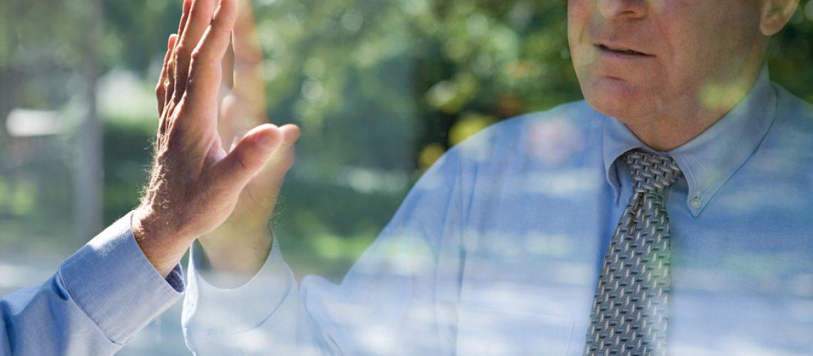 Man,Looking,At,His,Reflection