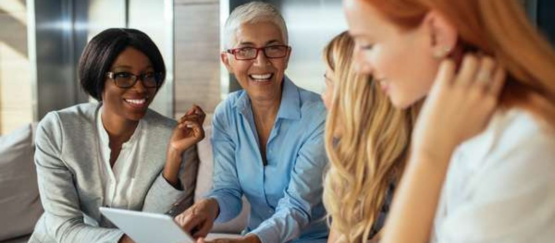 Business women talking happy planning