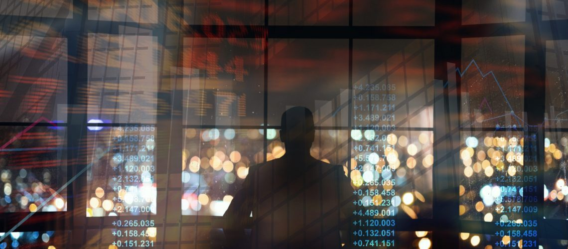 Silhouette of businessman looking on night metropolis, collage with finance info on imaginary screen. Panorama