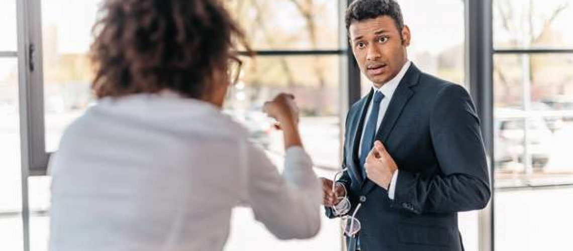 Employees fighting arguing in the workplace