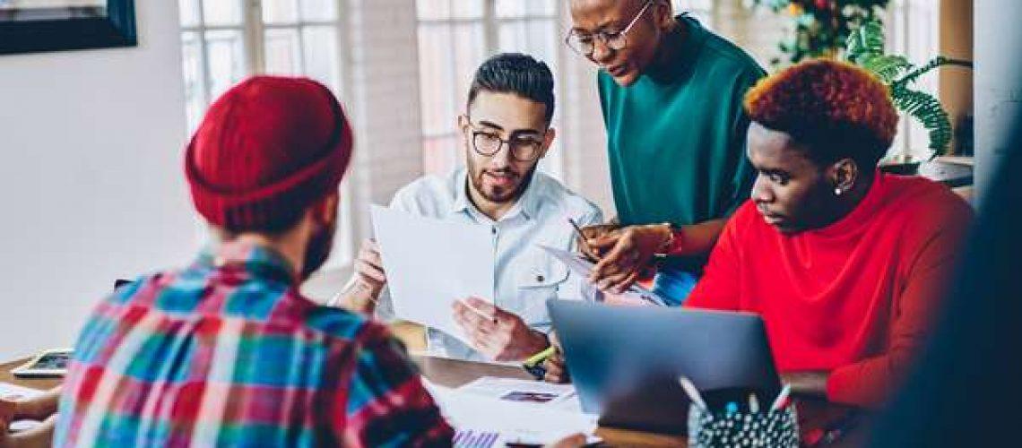 Leader helping employees teaching mentoring explaining