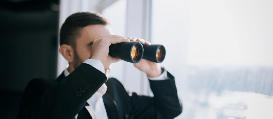 business-man-binoculars