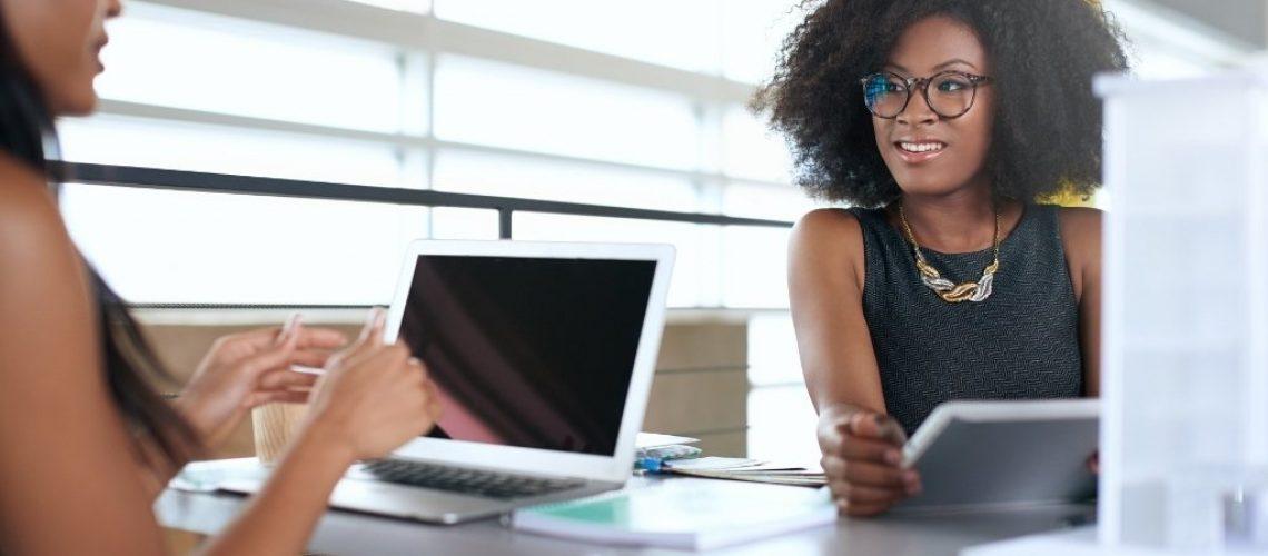 business_women_talking_engaging_working