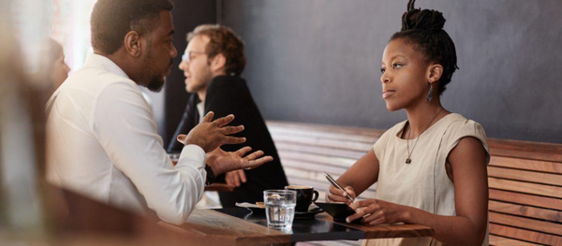 businessman-and-woman-talking-to_man_coaching_mentoring