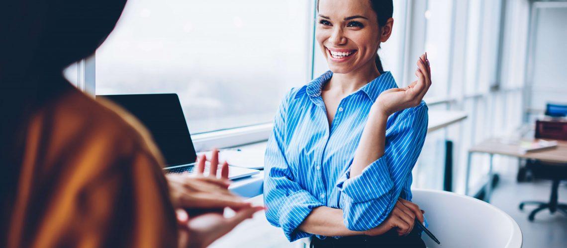 businesswomen chatting happy office work
