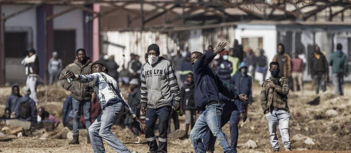civil unrest loot riot