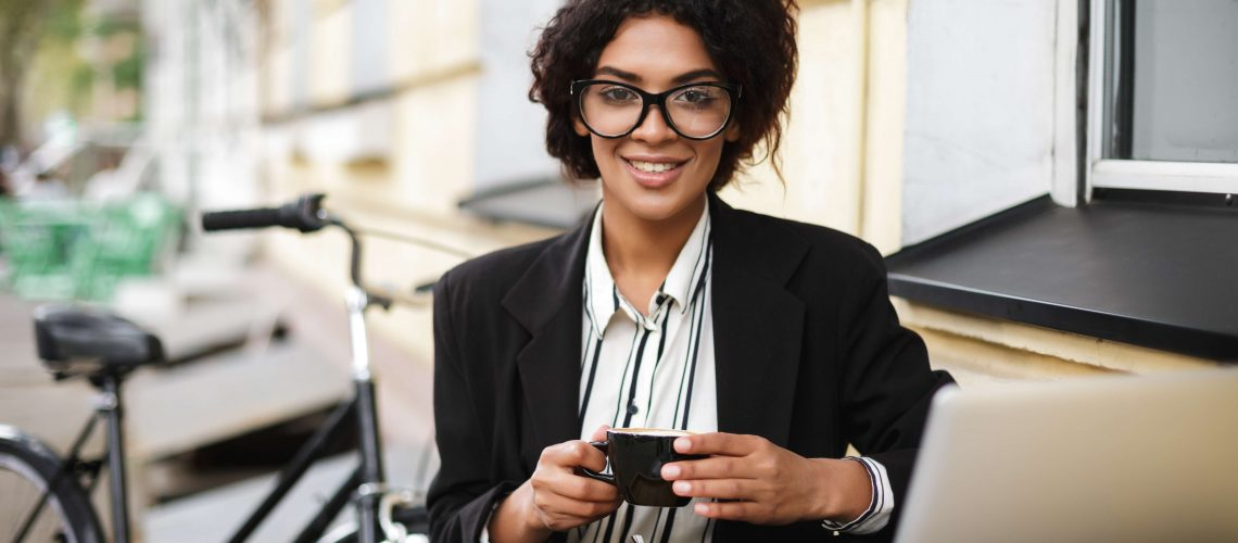 gig economy woman working at coffee shop