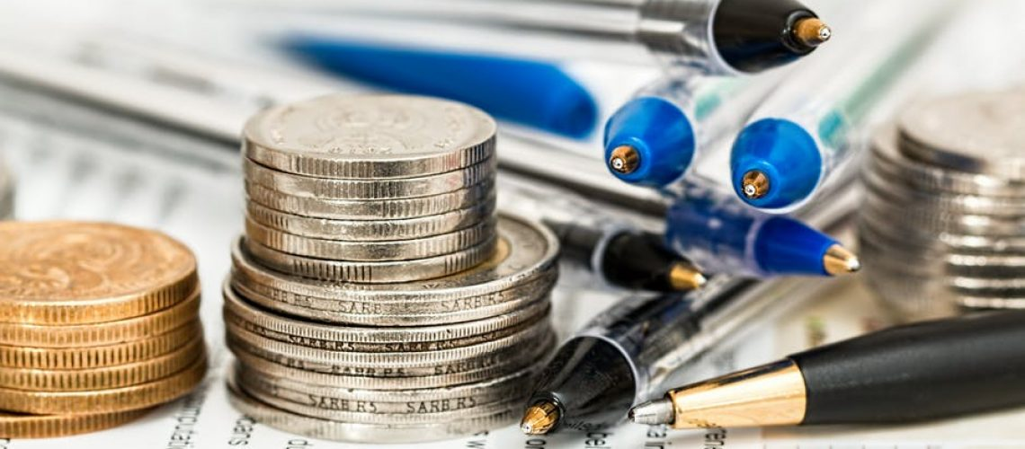 money_coins_pens_and_documents